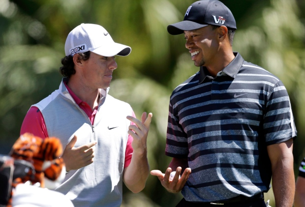 Tiger Woods talks with Rory McIlroy