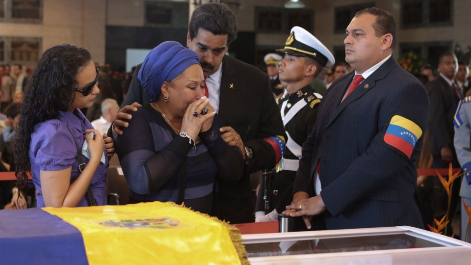 Colombian former senator Piedad Cordoba, Hugo Chavez's daughter Rosa Virginia Chavez and Venezuela's Vice President Nicolas Maduro stand next to the coffin containing the body of Venezuela's late President Hugo Chavez during his wake in Caracas, Venezuela, Thursday, March 7, 2013. (Miraflores Press Office)