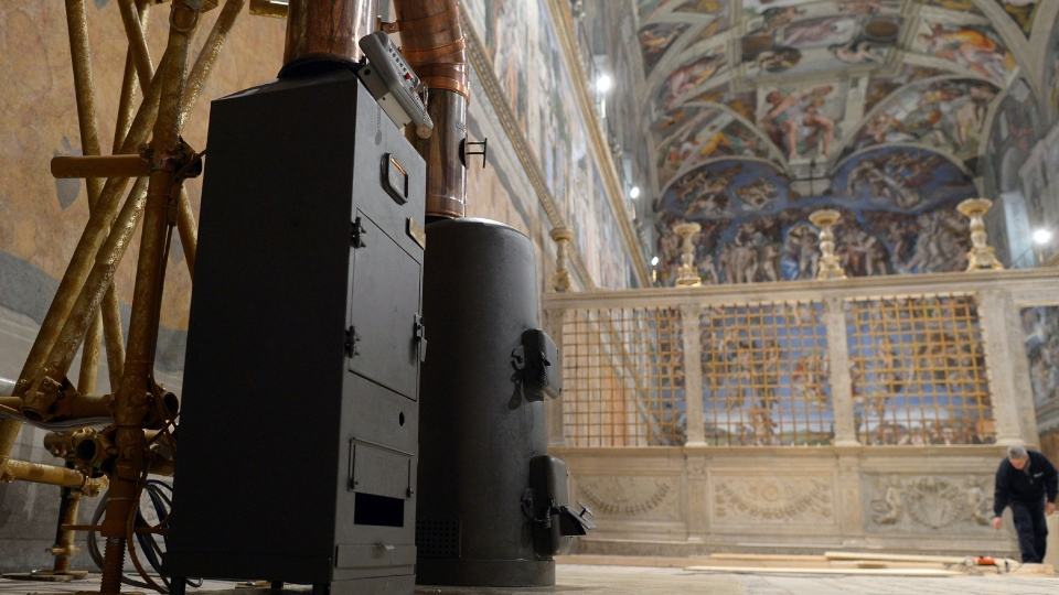 The stoves where the ballots will be burned during the conclave are shown inside the Sistine Chapel, at the Vatican, Friday, March 8, 2013. (L'Osservatore Romano)