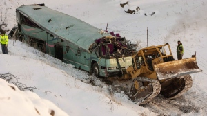 A piece of heavy equipment strains to move a bus which plummeted 200 feet down an embankment in rural Eastern Oregon the day before, on Monday, Dec. 31, 2012. (The Oregonian, Randy L. Rasmussen)