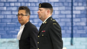 Maj. Darryl Watts (right) and lawyer Balfour Der arrive for court martial proceedings in Calgary, Alberta on Wednesday, Nov. 14, 2012. (Larry MacDougal / THE CANADIAN PRESS)