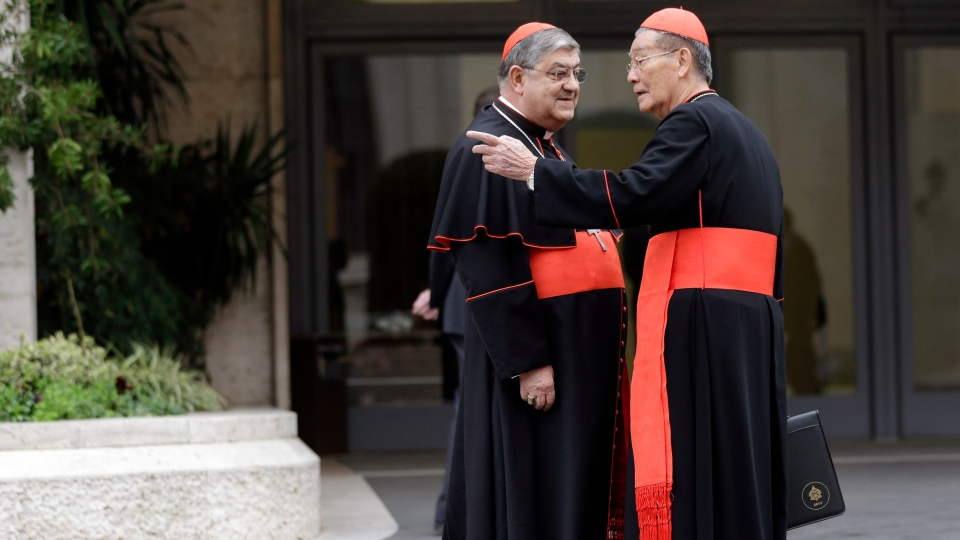 Cardinal Jean-Baptiste Pham Minh Man, right, shares a word with Cardinal Crescenzio Sepe as they arrive for a meeting at the Vatican, Friday, March 8, 2013. (AP / Alessandra Tarantino)