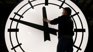 Removin the hands of a clock being shipped to Wisconsin, at the Electric Clock factory in Medfield Mass., on March 9, 2007. (Stephan Savoia / AP)