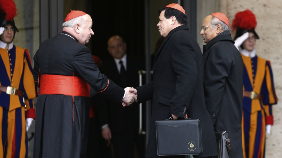 Cardinals Norberto Rivera Carrera and Albert Malcolm Ranjith Patabendige Don greet Cardinal Stanislaw Dziwisz as they arrive for a meeting at the Vatican, Friday, March 8, 2013. (AP / Alessandra Tarantino)