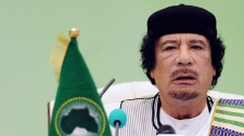 Libyan leader Moammar Gadhafi talks during the first session of the 3rd Africa-EU Summit in Tripoli, Libya, Monday, Nov. 29, 2010. (AP / Geert Vanden Wijngaert)