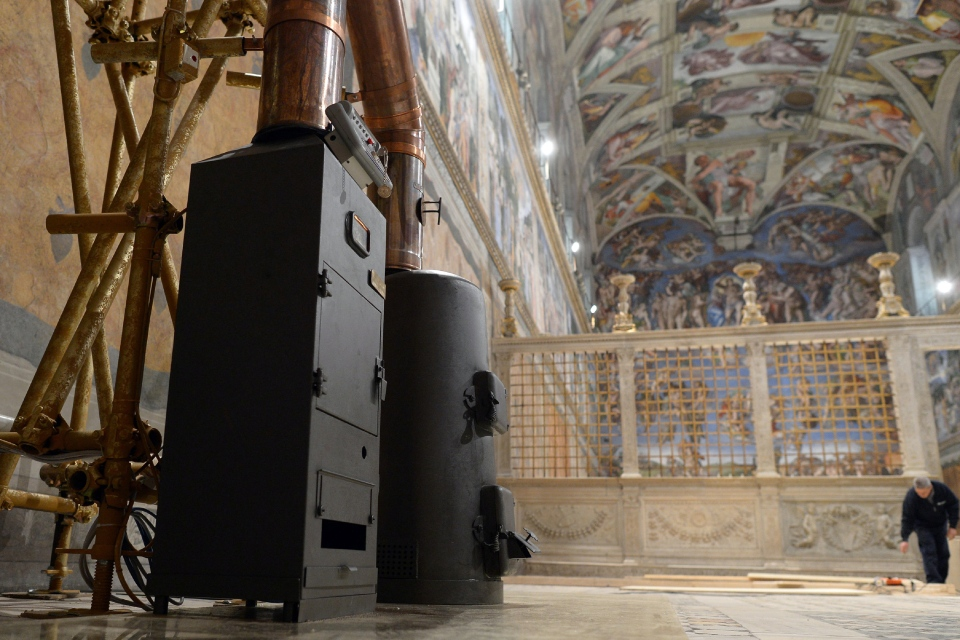 This photo provide by the Vatican newspaper L'Osservatore Romano shows the stoves where the ballots will be burned during the conclave, inside the Sistine Chapel, at the Vatican, Friday, March 8, 2013. (AP Photo/L'Osservatore Romano)