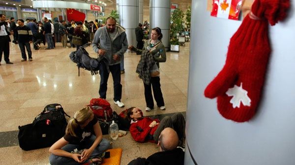 Canadian tourists wait for a flight out of Cairo's international airport, outside Cairo, Egypt, Monday Jan. 31, 2011. (AP / Victoria Hazou)