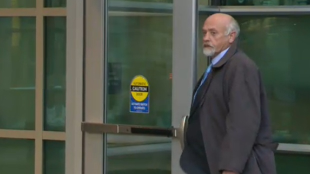 Barry David Brown enters the Calgary Courthouse on March 8, 2013