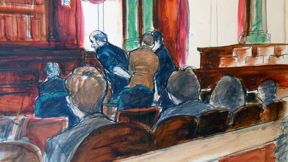 In this courtroom drawing, Osama bin Laden's son-in-law, Sulaiman Abu Ghaith, leans forward as he is handcuffed in U.S. federal court in Manhattan, after a hearing where he pleaded not guilty Friday, March 8, 2013. (AP Photo / Elizabeth Williams)