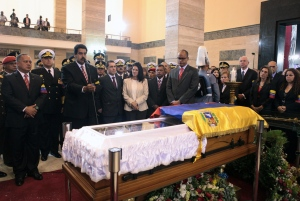 Venezuela's acting President Nicolas Maduro, second from left, speaks in front of the coffin containing the remains of Venezuela's late President Hugo Chavez after a symbolic swearing in ceremony at the military academy where the funeral ceremony was held earlier in Caracas, Venezuela, Friday, March 8, 2013. (AP / Miraflores Press Office)