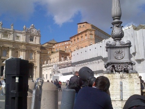 Photographers stake out 'Citta del Vaticano.' Up high in the distance you can see construction crews were busy working on the Sistine Chapel. (Lisa LaFlamme/CTV News)