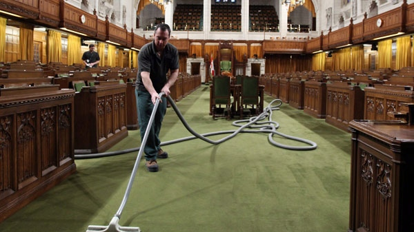 Sylvain Sauve cleans the House of Commons on Parliament Hill in Ottawa, Thursday, Jan. 27, 2011. (Fred Chartrand / THE CANADIAN PRESS)