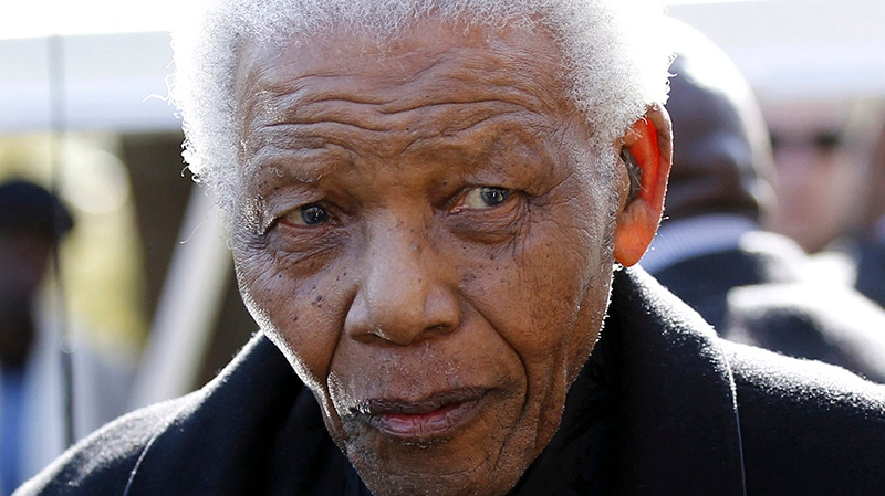 Former South African President Nelson Mandela leaves the chapel after attending the funeral of his great-granddaughter Zenani Mandela in Johannesburg, South Africa, June 17, 2010.  (AP / Siphiwe Sibeko)