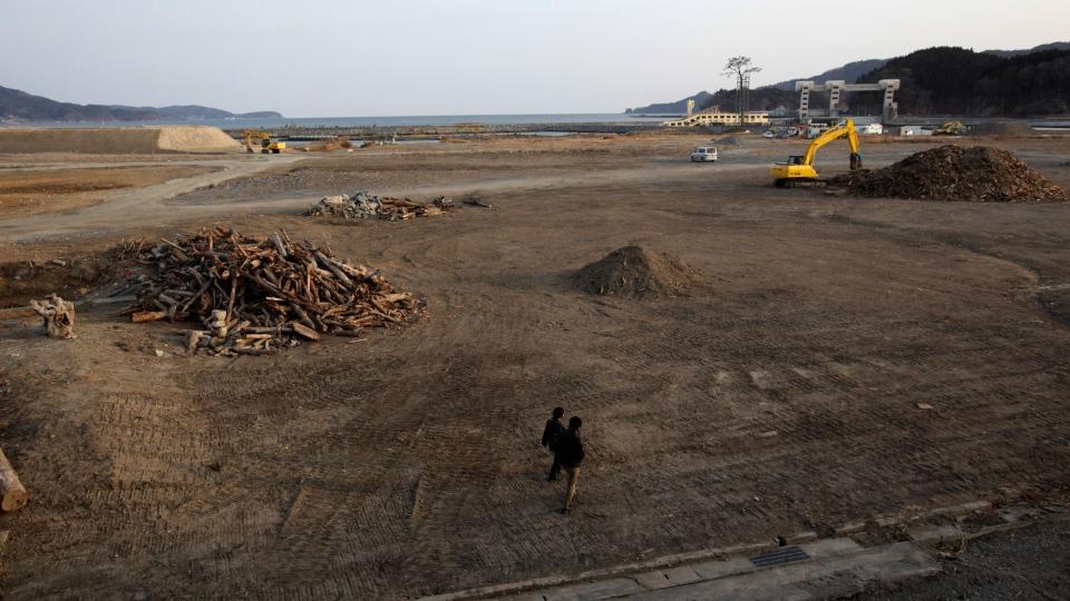 Visitors walk at the tsunami-stricken area in Rikuzentakata, Iwate Prefecture, northern Japan, Saturday, March 9, 2013. (AP / Shizuo Kambayashi)
