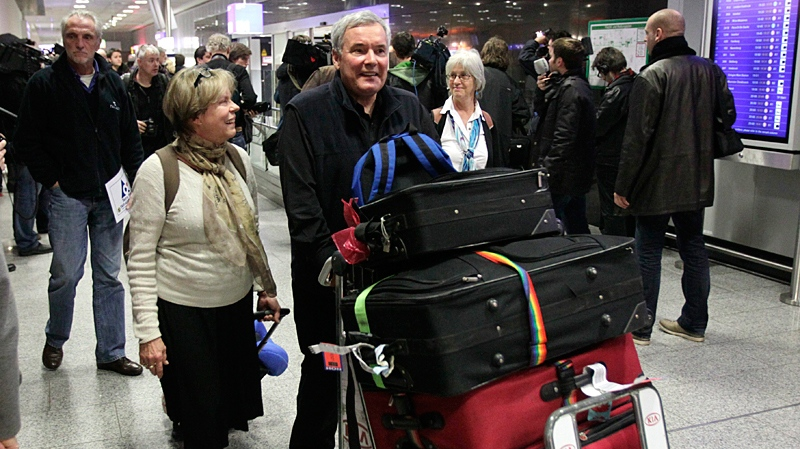 Bill Parent from Toronto, Canada, and his wife Diane, arrive at the airport in Frankfurt, central Germany, Monday, Jan. 31, 2011. (AP / Michael Probst)