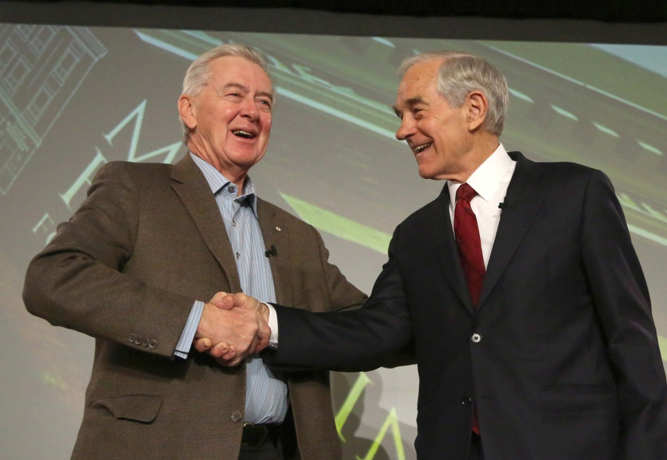 Ron Paul (right), former U.S. Republican primary candidate, shakes hands with Preston Manning, former leader of the Reform Party, at the Manning Conference in Ottawa on Friday, March 8, 2013. (Patrick Doyle / THE CANADIAN PRESS)