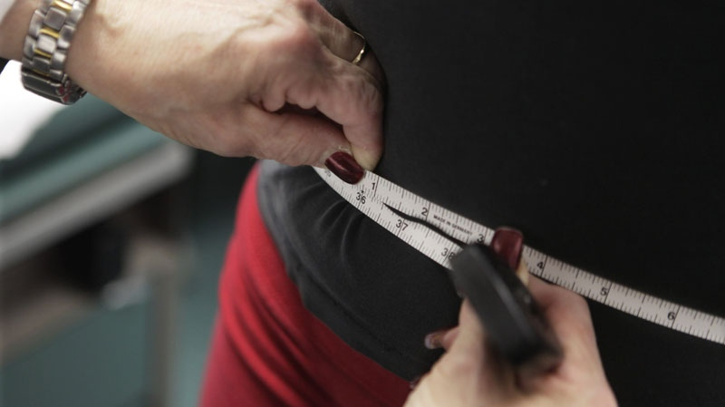 The Heart and Stroke Foundation's 2011 report card finds that while most Canadians know what a healthy lifestyle looks like, they're not necessarily living it. According to the 2007-09 Canadian Health Measures Survey and other data from Statistics Canada, almost 25 per cent of Canadian adults are obese. (AP / M. Spencer Green)