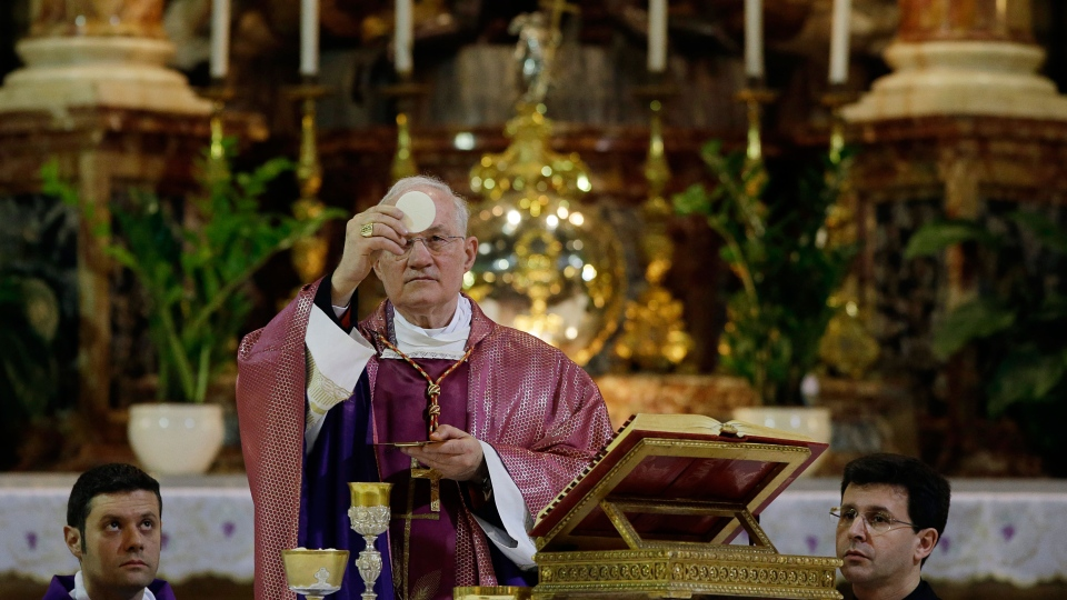Cardinal Marc Ouellet celebrates Mass at the Santa Maria in Transpontina church in Rome, Sunday, March 10, 2013. (AP / Gregorio Borgia)