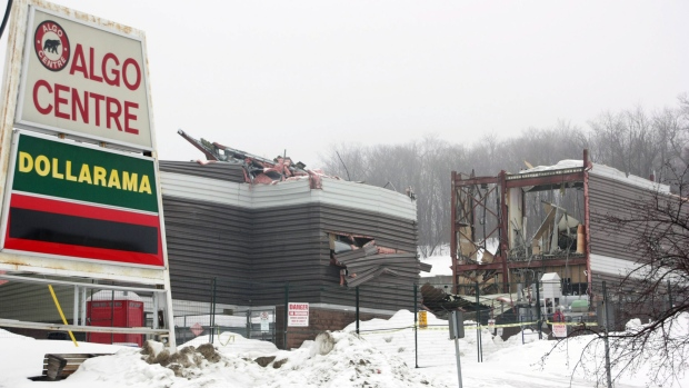 Demolition of the ill-fated Algo Centre Mall continues in Elliot Lake, Ont., on Sunday, March 10, 2013. The mall's roof-top garage collapsed June 23, 2012, killing two women. ( Colin Perkel / THE CANADIAN PRESS)