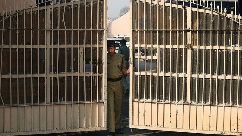 An Indian police officer prepares to close one of the gates at Tihar Jail, the largest complex of prisons in South Asia, in New Delhi, India, Monday, March 11, 2013. (AP / Saurabh Das)
