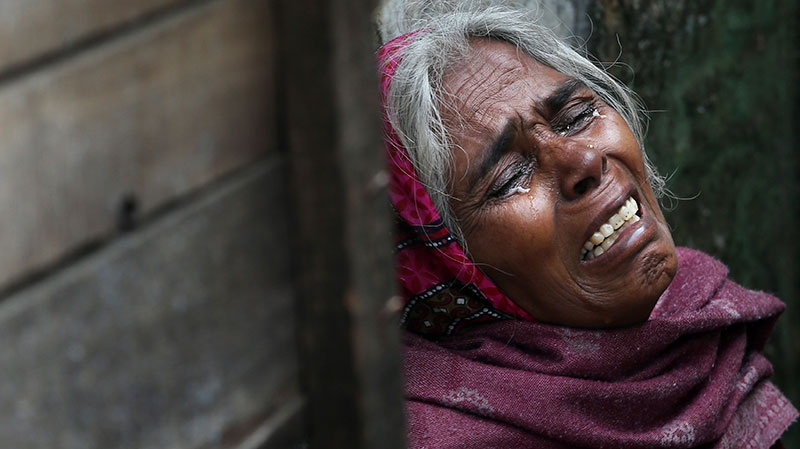 The mother of Ram Singh cries as she speaks to journalists outside the family's home in New Delhi, India, Monday, March 11, 2013. (AP / Manish Swarup)