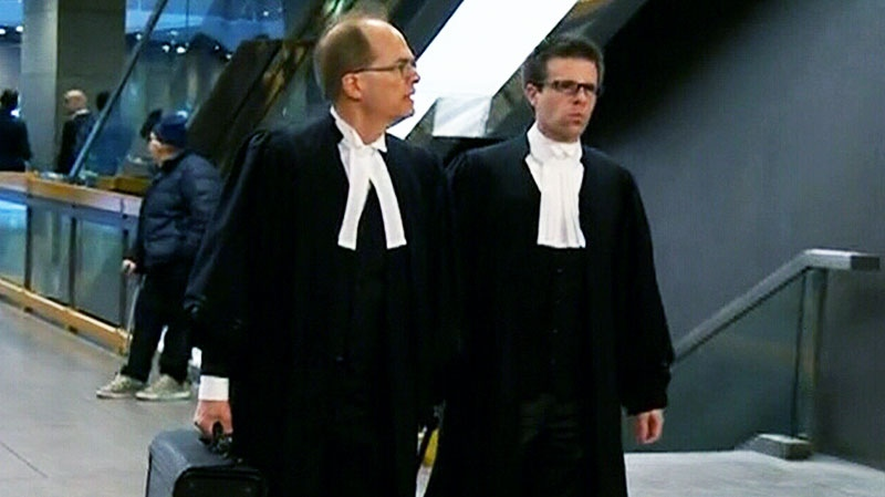 Prosecutors arrive at the Montreal courthouse where Luka Magnotta will face his preliminary hearing Monday, March 11, 2013.