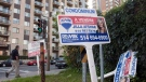 For sale signs stand in front of a condominium in Montreal in 2011 file photo. (Ryan Remiorz/ THE CANADIAN PRESS)