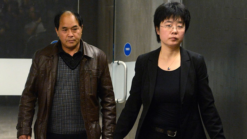 Daran Lin, father of murder victim Jun Lin, heads to court with a translator in Montreal on Monday, March 11, 2013. (Ryan Remiorz / THE CANADIAN PRESS)