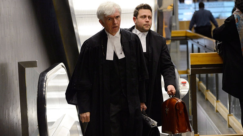 Lawyer Luv Leclerc enters court where a preliminary hearing is set to start for his client, Luka Rocco Magnotta, in Montreal on Monday, March 11, 2013. (Ryan Remiorz / THE CANADIAN PRESS)