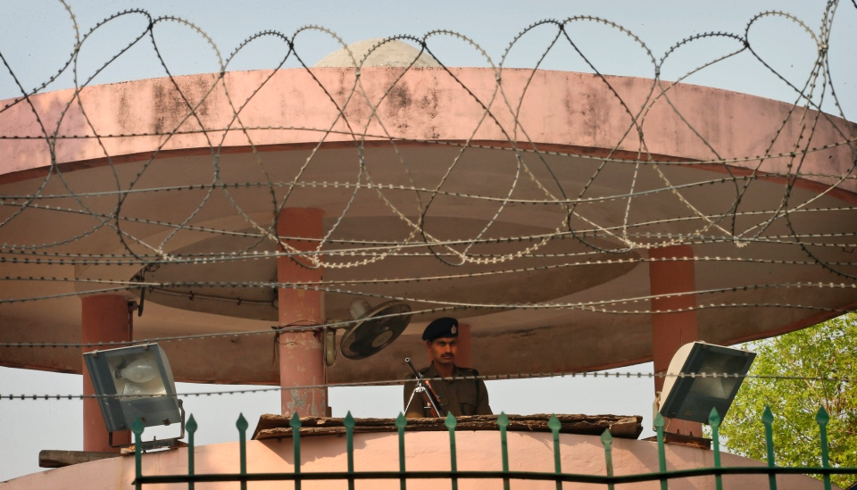 An Indian police officer stands guard inside Tihar Jail, the largest complex of prisons in South Asia, in New Delhi, India, Monday, March 11, 2013. (AP / Saurabh Das)