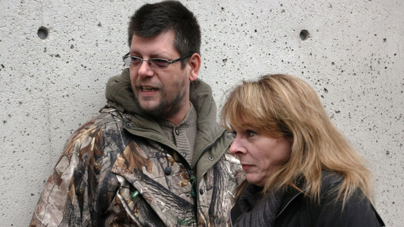 William Mullins-Johnson, wrongfully jailed for murdering his niece, is seen with his fiancee Christine Rupert outside a disciplinary hearing for disgraced pathologist Dr. Charles Smith in Toronto on  Tuesday, Feb. 1., 2011. The hearing stripped Smith of his medical licence. (Colin Perkel / THE CANADIAN PRESS)
