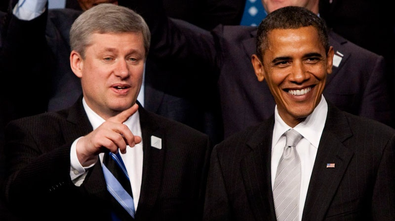Prime Minister Stephen Harper, left, and United States President Barack Obama join the G20 leaders during the official family photo at the G20 Summit in Toronto, Ont., on June 27, 2010. (Sean Kilpatrick / THE CANADIAN PRESS)