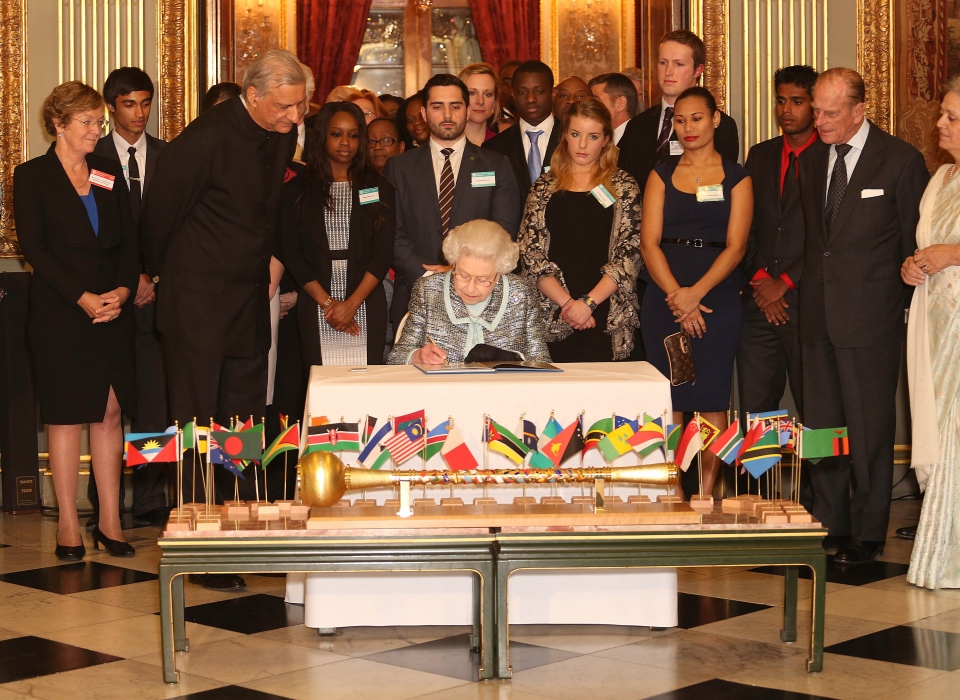 Queen Elizabeth II signs the Commonwealth Charter at a reception at Marlborough House, London, Monday, March 11, 2013. (PA, Philip Toscano)
