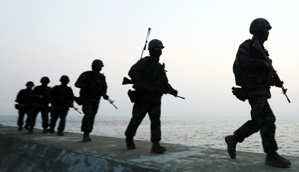 South Korean Marines patrol on Yeonpyeong Island, South Korea, Tuesday, March 12, 2013. (Yonhap / Yun Tae-hyun)