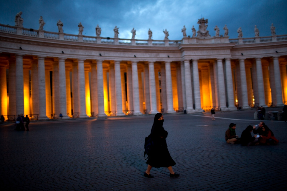 A nun walks inside St. Peter's Square, at the Vatican, Monday, March 11, 2013. (AP / Emilio Morenatti)