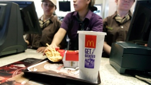 McDonald's employees serve a meal containing a large soda in New York on Tuesday, June 12, 2012.  (AP / Mary Altaffer)