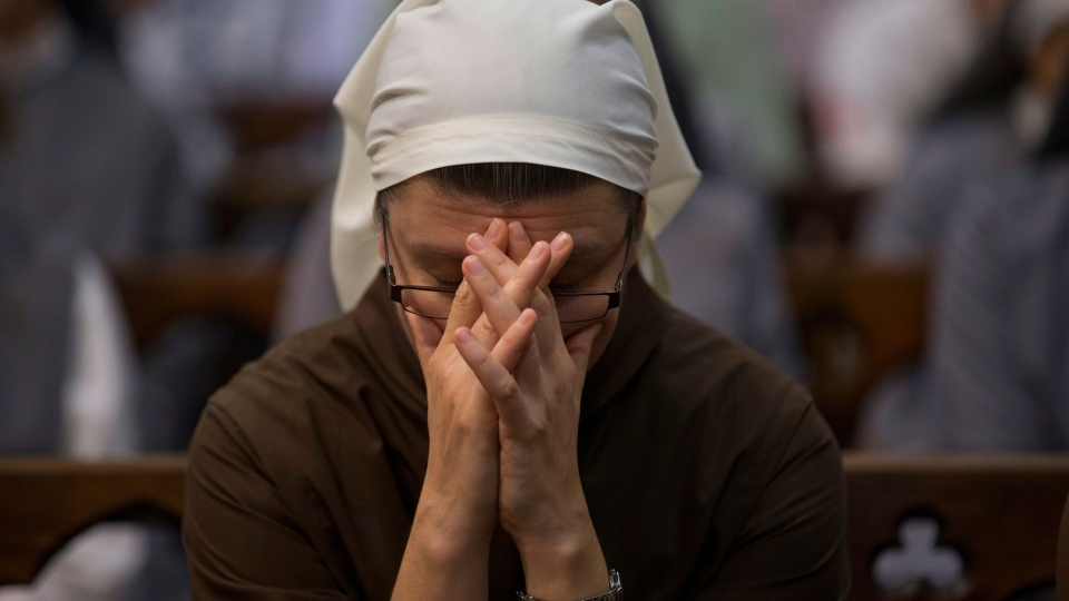 A nun clasps her hands in prayer during a Mass honoring Pope Benedict XVI at the Metropolitan Cathedral in Buenos Aires, Argentina, on Feb. 27, 2013. (AP / Natacha Pisarenko)