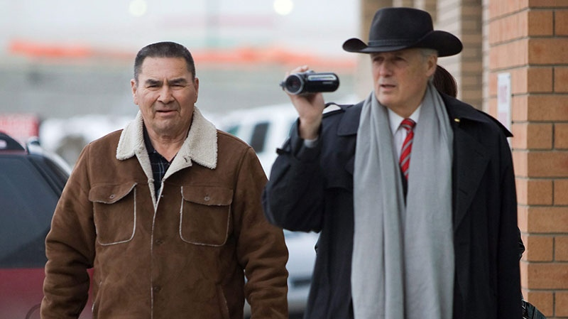 Former aboriginal leader David Ahenakew, left, arrives at court with lawyer Doug Christie, prior to receiving a not guilty verdict in his second hate crime trial in Saskatoon, Sask., Monday, Feb. 23, 2009. (Geoff Howe / THE CANADIAN PRESS)