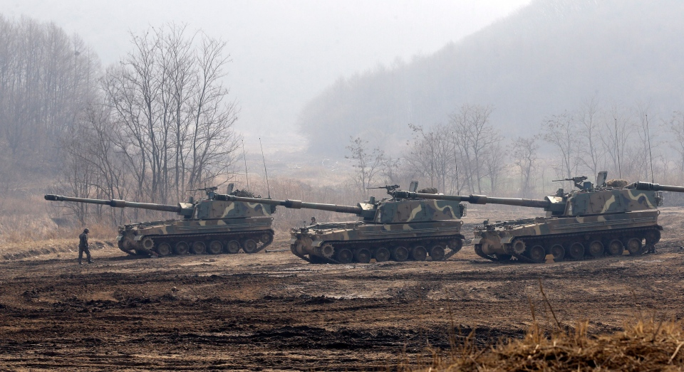 South Korean soldiers walk near their armored vehicles during an exercise near the border village of Panmunjom, which has separated the two Koreas since the Korean War, in Paju, north of Seoul, South Korea, on March 12, 2013. (AP Photo/Lee Jin-man)