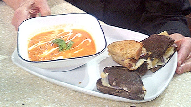 Roasted tomato and red pepper soup with grilled cheese and onions sandwiches by Chef Gail Hall.
