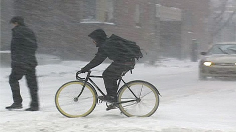 Despite the heavy snow, this cyclist hit the streets in Ottawa, Wednesday, Feb. 2, 2011.