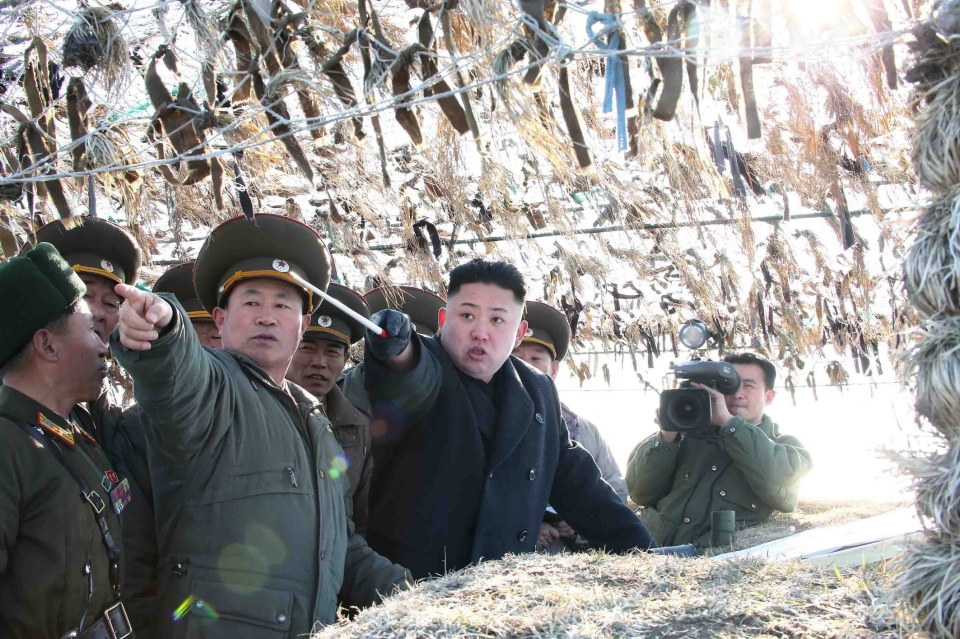 In this photo released by the Korean Central News Agency (KCNA) and distributed March 12, 2013 by the Korea News Service, North Korean leader Kim Jong Un, third left, looks at South's western border island of Baengnyeong during his visit to the Wolnae Islet Defense Detachment, North Korea, March 11, 2013. (AP / KCNA via KNS)
