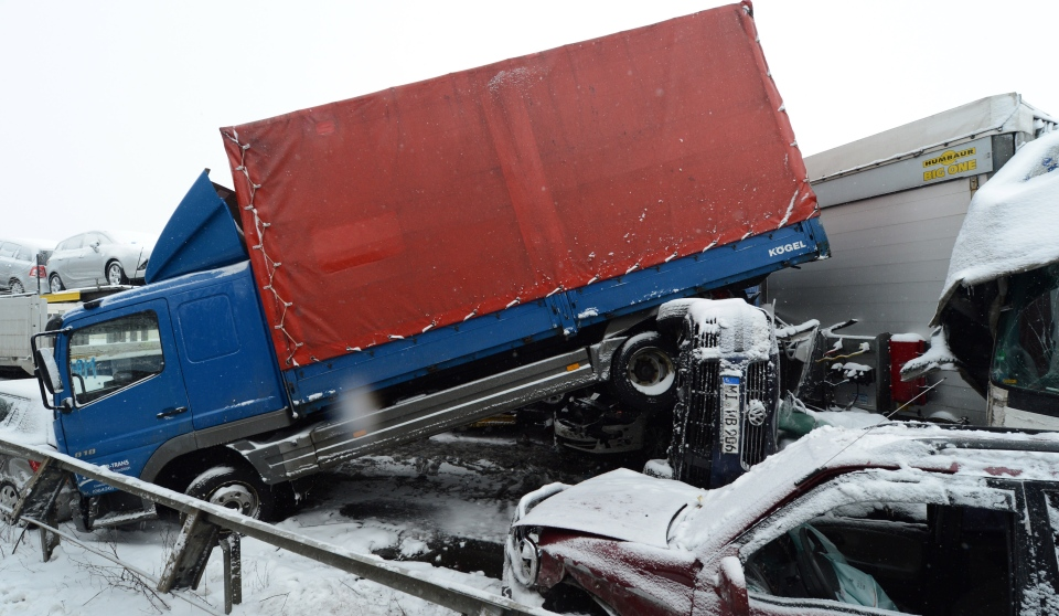 Wrecked cars and trucks are piled up after a mass-crash on highway A45 near Woelfersheim, central Germany, Tuesday. March 12, 2013. (AP / dpa, Boris Roessler)