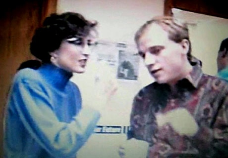 Brad Wall (right) gives a mock interview to then Saskatchewan Party worker Kathy Young in this video framegrab taken from a 1991 video.(THE CANADIAN PRESS)