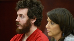 James Holmes sits with defense attorney Tamara Brady during his arraignment in district court in Centennial, Colo., on Tuesday, March 12, 2013. (AP / Denver Post, RJ Sangosti, Pool)
