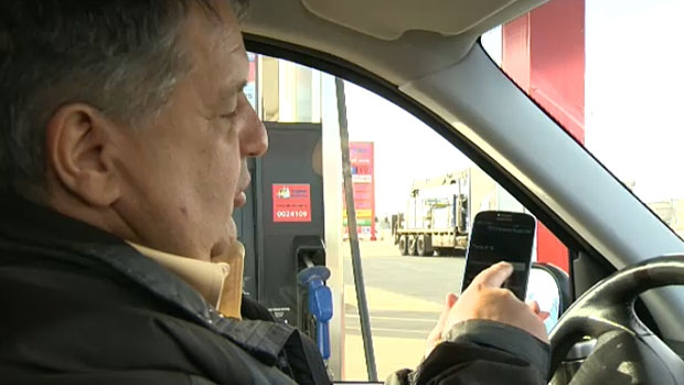 A driver tests out the new Hughes Mobile App, which lets users pay for their gas using their phone - from their comfort of their vehicle. The app is just the start of what some say will be widespread mobile payment options seen in Canada later this year.