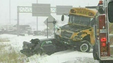 A school bus is shown on top of another vehicle following a highway pileup in Montreal on Wednesday, Feb. 2, 2011.