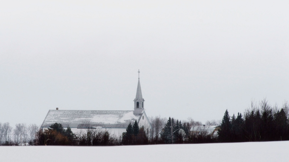 The church is seen across farmers fields in La Motte, Que., Monday, March 11, 2013. (Adrian Wyld / THE CANADIAN PRESS)
