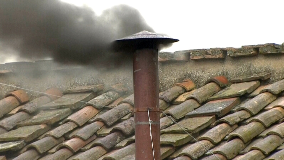 Black smoke pours out of chimney atop Sistine Chapel indicating the third ballot is over, Wednesday, March 13, 2013.