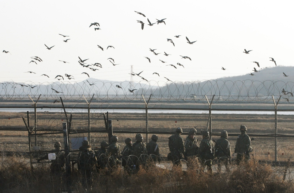 "South Korean army soldiers gather to patrol near the border village of Panmunjom in Paju, South Korea, Wednesday, March 13, 2013. The body that controls North Korea's military dismissed new South Korean President Park Geun-hye, the first woman to hold the office, with a sexist reference Wednesday to the ""venomous swish"" of her skirt.(AP Photo/Ahn Young-joon)."